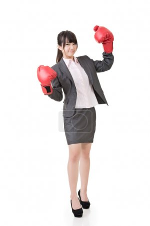 Asian business woman with boxing gloves.