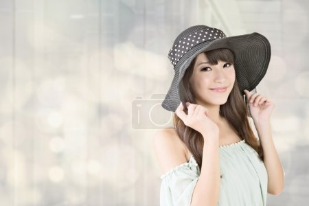 Elegant asian woman with hat