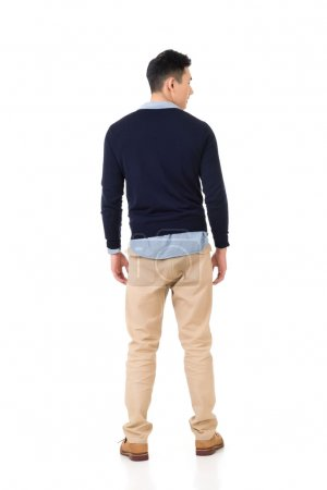 Rear view of young Asian man
