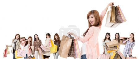 Happy Asian shopping girls