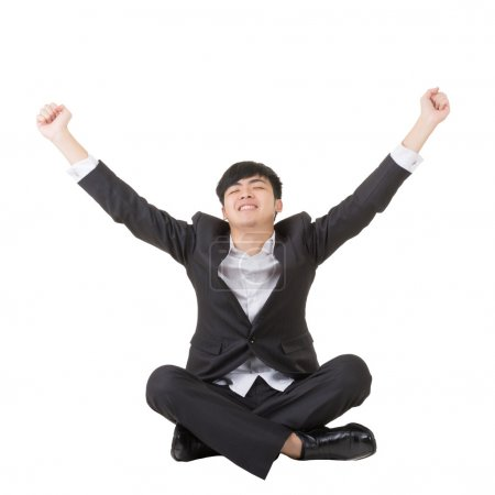 Young asian businessman sit and feel freedom