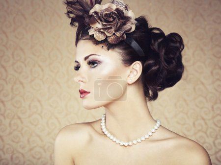 Retro portrait of beautiful woman. Vintage style
