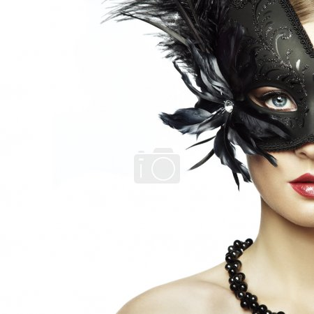 Photo for Beautiful young woman in black mysterious venetian mask. Fashion photo - Royalty Free Image