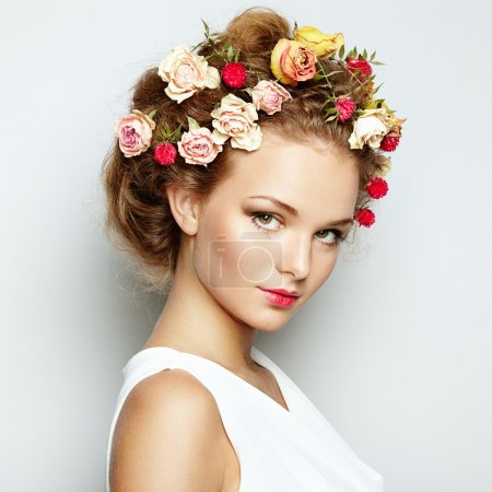 Beautiful woman with flowers. Perfect face skin. Beauty Portrait