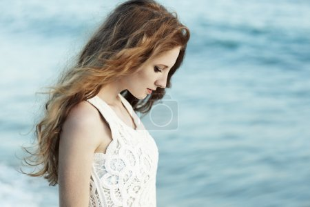 Photo for Beautiful woman with red hair at the sea. Fashiob photo - Royalty Free Image