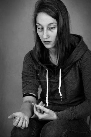 Dramatic B&W of female junkie