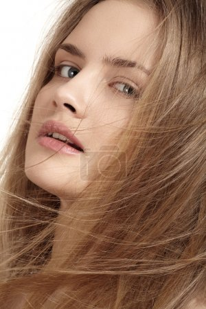 Foto de Health, beauty, wellness, haircare, cosmetics and make-up. Beautiful fashion hairstyle. Woman model with shiny straight long hair and fashion natural make-up. - Imagen libre de derechos