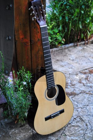 Photo for Acoustic guitar outside - Royalty Free Image