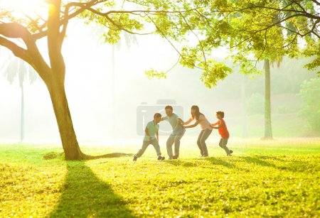 Photo for Happy Asian family playing together at outdoor park - Royalty Free Image