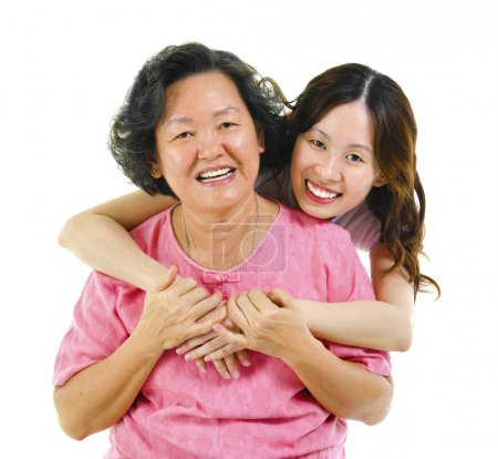 Photo for Happy Asian senior mother and adult daughter over white background - Royalty Free Image