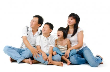 Photo for Happy Asian family looking at side, sitting on white background - Royalty Free Image