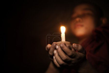Photo for Young novice monk holding a candlelight - Royalty Free Image