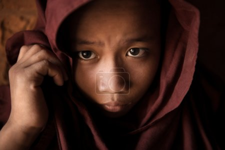 Photo for A young novice monk covered his head by robe - Royalty Free Image