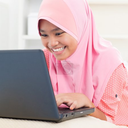 Asian teenager using notebook