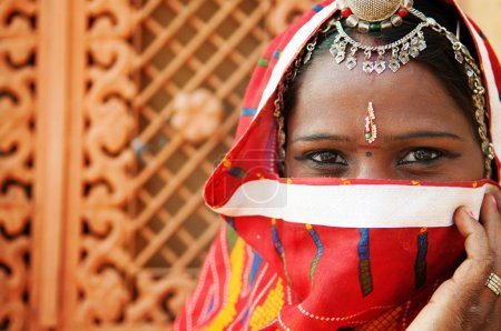 Photo for Traditional Indian woman in sari costume covered her face with veil, India - Royalty Free Image