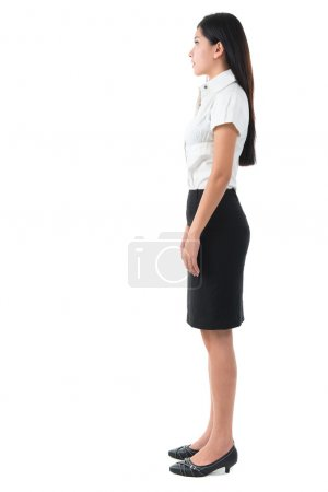 Photo for Full body side view of beautiful Asian young woman standing on white background - Royalty Free Image