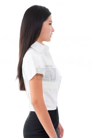 Photo for Side view of beautiful Asian young woman standing on white background - Royalty Free Image