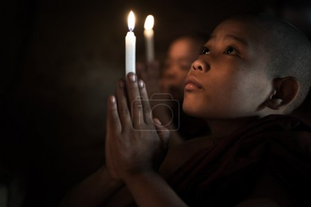 Little monks praying