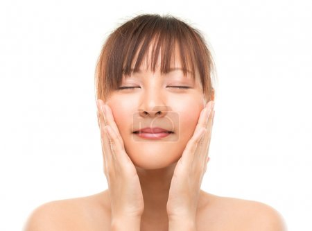 Asian skincare woman pampering face skin