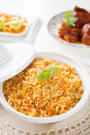 Biryani rice or briyani rice, curry chicken and sa...