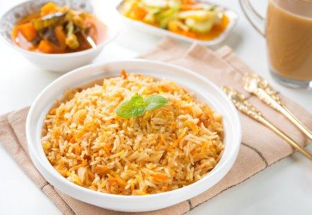 Indian vegetarian food. Biryani rice, curry dhal a...