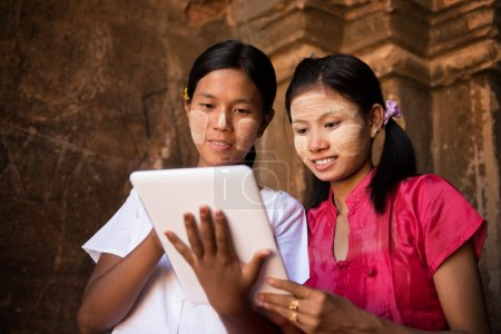 Myanmar girl using digital tablet pc