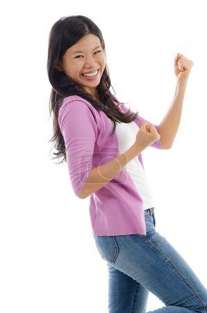Photo for Portrait of excited Asian woman celebrating success isolated over white background - Royalty Free Image