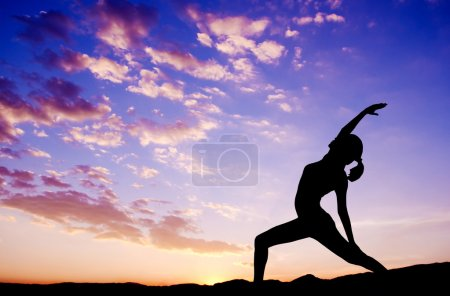 Photo for Silhouette of healthy woman doing yoga meditation during sunrise with natural sunlight outdoor. - Royalty Free Image