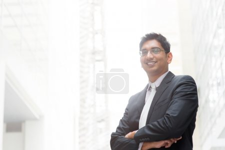 Photo for Portrait of happy and confident 30s Asian Indian businessman smiling. India male business man, real modern office building as background. - Royalty Free Image