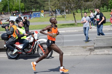 Bernard Kipkorir Talam runs on April 27, 2014 in Belgrade marathon. Bernard Kipkorir Talam wins after running 42 km and 195 meters in 2 hours, 14 minutes and 35 seconds