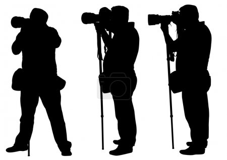 Photographers with monopod silhouettes
