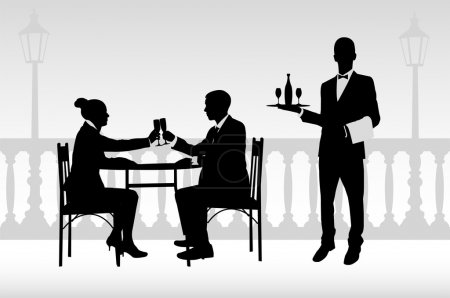 Couple in the restaurant and waiter serving them