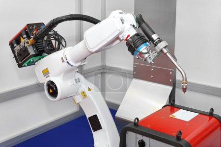 Photo for White robotic arm for welding in factory - Royalty Free Image
