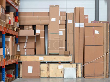 Photo for Cardboard boxes with equipment in distribution warehouse - Royalty Free Image