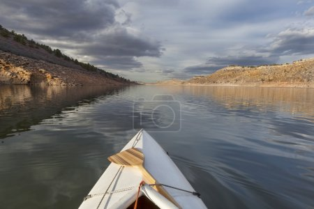 Canoe on mountain lake