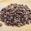 Close-up of a pile of raw cacao nibs on a grunge w...