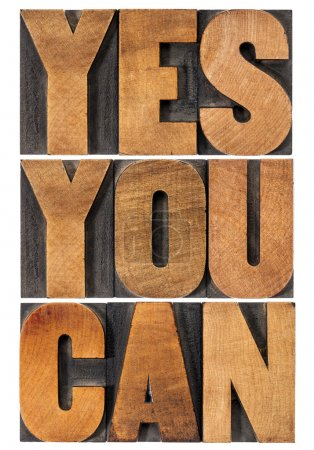 Photo for Yes you can - motivational slogan - isolated text in vintage letterpress wood type printing block, rectangular layout - Royalty Free Image