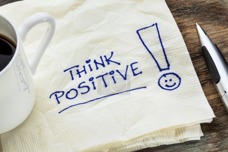 Photo for Think positive - motivational slogan on a napkin with a cup of coffee - Royalty Free Image