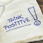 Think positive - motivational slogan on a napkin w...