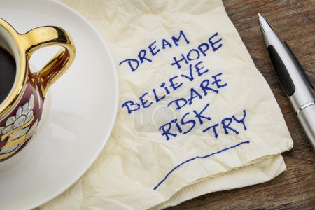 Photo for Dream, hope, believe, dare, risk, try - motivational words - a napkin doodle with a cup of espresso coffee - Royalty Free Image