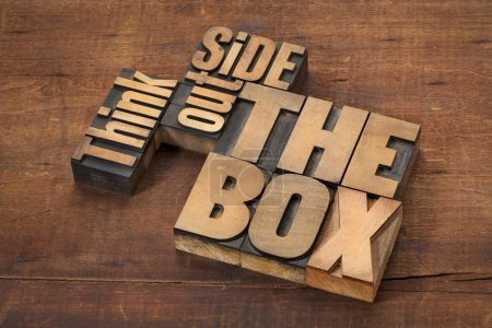Photo for Think outside the box - word abstract in letterpress wood type on a grunge wooden surface - Royalty Free Image