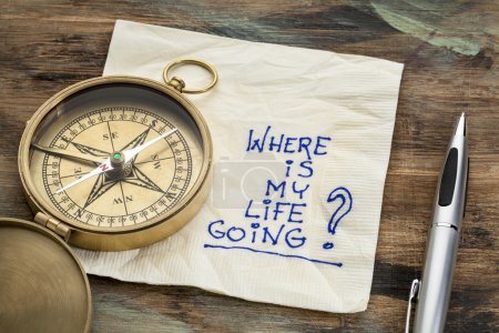Photo for Where is my life going - an essential question or searching for purpose - a napkin doodle with a brass compass - Royalty Free Image