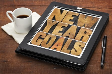 Photo for New Year goals - resolutions concept - text in vintage letterpress wood type on a digital tablet screen - Royalty Free Image