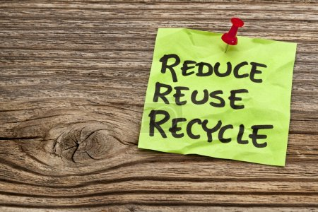 Photo for Reduce, reuse and recycle reminder note against grained wood - resource conservation concept - Royalty Free Image