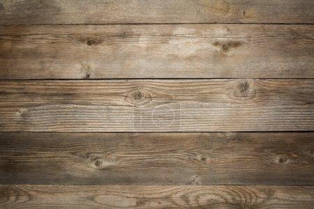 Photo pour Fond rustique en bois altéré avec du grain et des nœuds - image libre de droit
