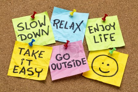 Photo for Slow down, relax, take it easy, enjoy life -  motivational lifestyle reminders on colorful sticky notes - Royalty Free Image