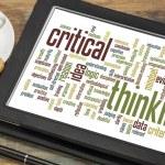 Critical thinking word cloud on a digital tablet w...