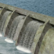 3d render of a water dam with flowing water....