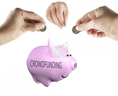 Male hands bringing money to a piggy bank with word