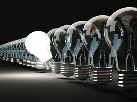 Photo for Row of light bulbs on black background - Royalty Free Image